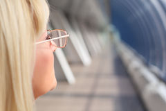 Closeup businesswoman in glasses from profile Royalty Free Stock Photo