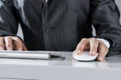 Closeup of businesswoman hand typing on keyboard with mouse on w royalty free stock photo