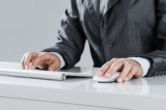 Closeup of businesswoman hand typing on keyboard with mouse on w stock photo