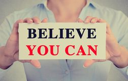 Closeup businesswoman hands holding sign with believe you can message Royalty Free Stock Photo