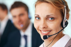 Closeup of a businesswoman with headset royalty free stock photos