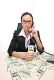 Closeup of businesswoman looking at camera and holding money. Stock Photography
