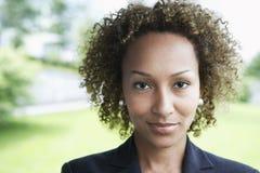 Closeup Of Businesswoman Outdoors. Closeup portrait of a smiling young businesswoman outdoors stock image