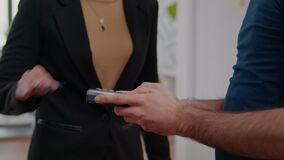 Closeup of businesswoman paying delivery food order with credit card using contactless