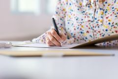 Closeup of businesswoman signing a document or contract royalty free stock images