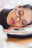Closeup of businesswoman sleeping on desk Stock Photo