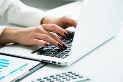 Closeup of businesswoman typing on laptop Stock Image