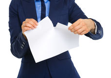 Closeup of businesswomans hands ripping a piece of paper Stock Photo