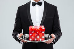 Closeup of butler holding tray with gift box Royalty Free Stock Photos