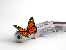 Closeup of butterfly on handgun | Concept war and peace Stock Images
