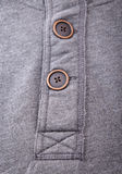 Closeup of the buttons on men hoodies. Stock Photo