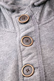 Closeup of the buttons on men hoodies. Royalty Free Stock Photos