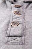 Closeup of the buttons on men hoodies. Closeup of the buttons on men hoodies Royalty Free Stock Photography