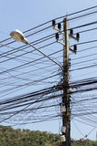 Closeup of a cable chaos at a power pole Stock Photo