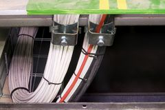 Closeup of cables in clamps. Grounding conductor, earth lead, ground lead with dust neutral conductors.  Stock Photo