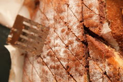 Closeup cake with powder sugar in tin and spatula Royalty Free Stock Photos