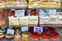 Closeup of cakes in a cake shop. Closeup of a variety of cakes in a cake shop royalty free stock image