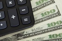 Closeup on calculator and dollars Stock Photos