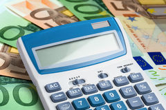 Closeup calculator eurobanknotes Stock Photography
