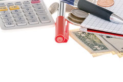 Closeup of calculator, marker, banknotes, coins and paper Royalty Free Stock Photos