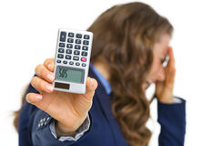 Closeup on calculator with sos inscription in hand of woman. Closeup on calculator with sos inscription in hand of frustrated business woman Royalty Free Stock Image