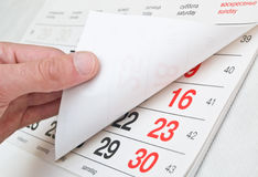 Closeup a calendar page. Fingers overturning the calendar page Royalty Free Stock Photography