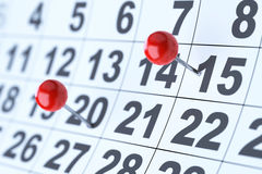 Closeup of the calendar with red pins. Soft focus Stock Photography
