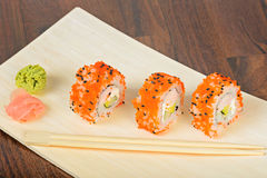 Closeup California maki sushi in row ot the table Royalty Free Stock Photography