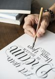 Closeup of a calligrapher working on a project Royalty Free Stock Image