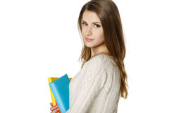 Calm woman holding books