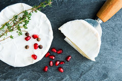 Closeup on camembert on stone substrate Stock Photos