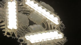 Closeup Camera Moves down Past Powerful Triangle LED Lamp stock video