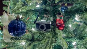 Closeup of camera and snowman decoration on Christmas tree. royalty free stock photography