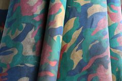 Closeup camouflage fabric pattern like military, but colorful color. It the material of big umbrella Royalty Free Stock Photography