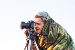 Closeup of a camouflaged paparazzi photographer  taking picture Stock Image