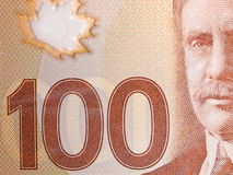 Closeup of a Canadian 100-dollar bill. Macro of Canadian 100-dollar bill stock image