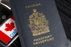 Closeup of Canadian passport sitting on suitcase Royalty Free Stock Image