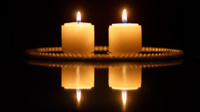 Closeup of candles on black stock video footage