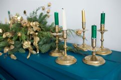 Closeup of candles and blurry Christmas garland Royalty Free Stock Photography