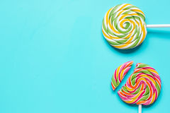 Closeup of candy on blue table background top view mockup Stock Image