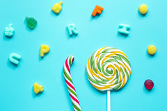 Closeup of candy on blue table background top view pattern Stock Image
