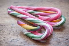 candy canes on wooden background Stock Photography