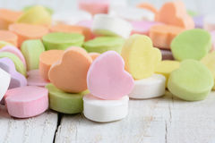 Closeup Candy Hearts on Wood Table Stock Photography