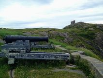 A closeup of a cannon overlooking the harbour in St. John`s newf. Oundland with Cabot Tower atop Signal Hill in the background. This was a lookout during world royalty free stock image