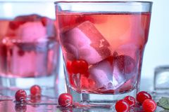 Closeup of a cape cod cocktail or vodka cranberry on a blue background. The closeup of a cape cod cocktail or vodka cranberry on blue studio background Stock Photography
