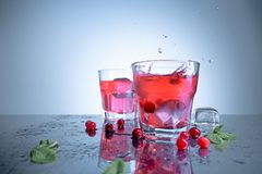 Closeup of a cape cod cocktail or vodka cranberry on a blue background. The closeup of a cape cod cocktail or vodka cranberry on blue studio background Stock Photo