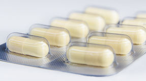 Closeup capsules and many pills packed in blisters Royalty Free Stock Photo