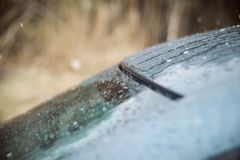 Closeup Car Wet Windshield and Windshield Wiper with Rain drop in Raining Season. Closeup Car anti-glare, rain drops on the windshield of a car Royalty Free Stock Images