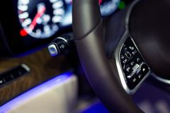 Closeup of car audio control button on the steering wheel stock photography