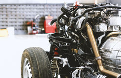 Closeup car chassis with engine. Soft-focus and over light in the background Royalty Free Stock Photos